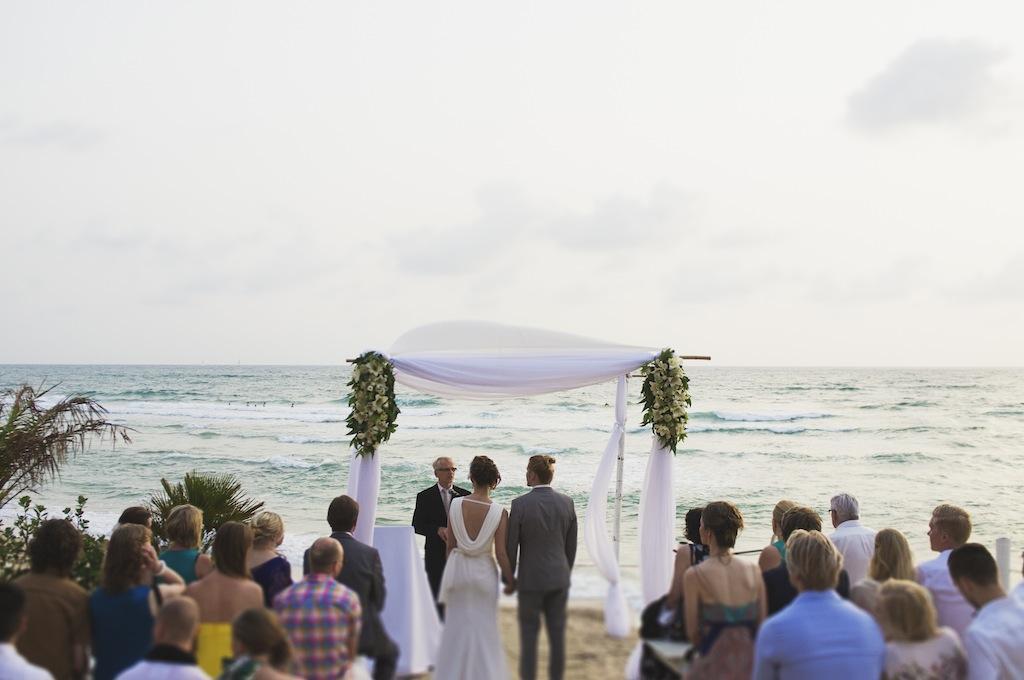 sunny-beach-wedding-olla designs chuppah with flowers